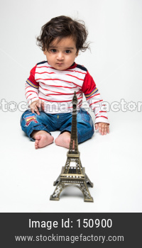 cute little Indian baby boy playing with toys