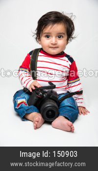 cute little Indian baby boy photographer with camera