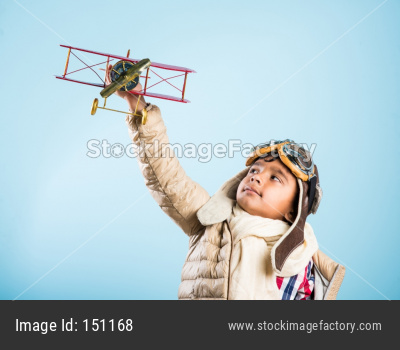 Indian boy pilot with antique plane
