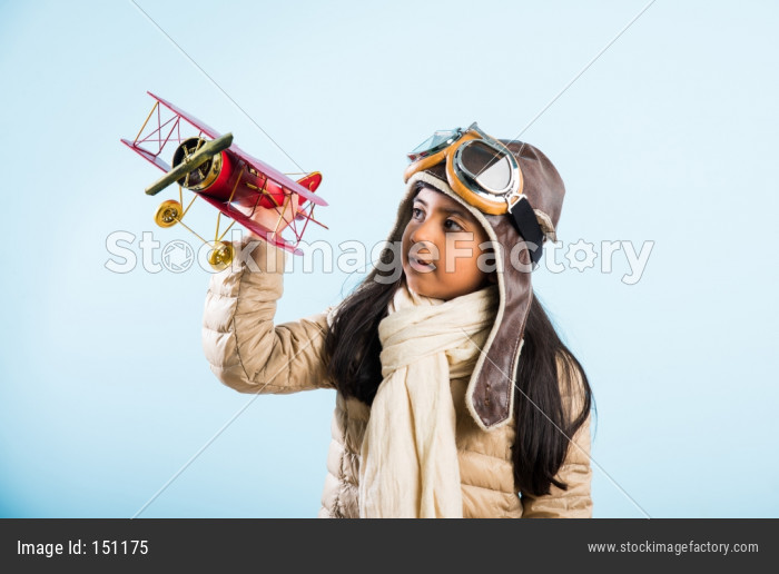 58037a57bb Indian Little Girl Pilot With Antique Plane Photo 0000151175 -  StockImageFactory