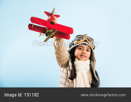 Indian little girl pilot with antique plane