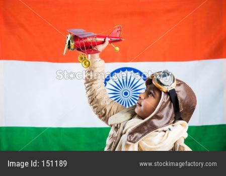 Indian boy pilot with antique plane