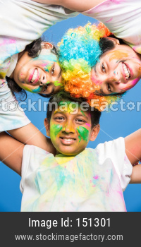 Kids playing with Holi colours