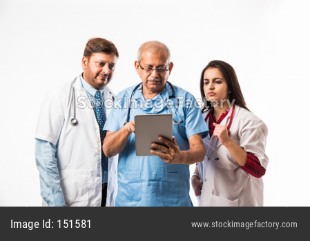 Doctors using technology - medical professionals or surgeons checking report on tablet computer