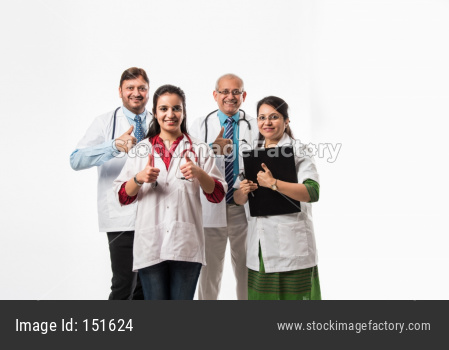 group of Indian doctors showing success sign or thumbs up