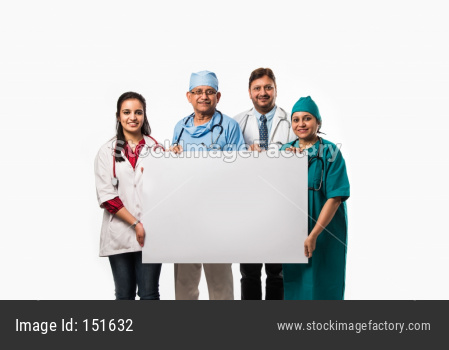 happy Indian/asian doctors holding blank white board