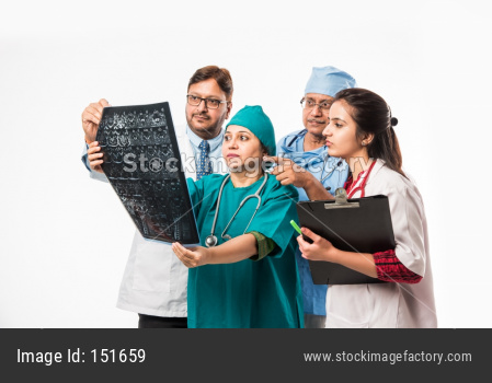 Indian/asian doctors looking an x-ray/MRI , isolated over white background. selective focus