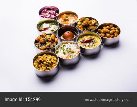 Assorted Indian Food in steel bowls