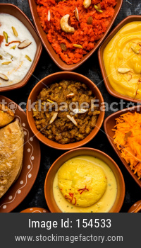 group of Indian Sweet / mithai in terracotta bowl