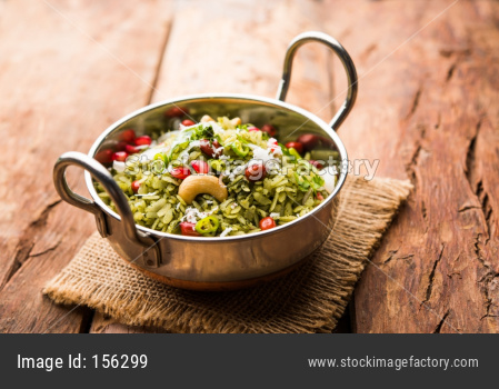 Hariyali Poha / Green Masala Pohe or flattened rice served in a bowl, selective focus