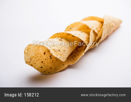 Gujarati papad or papadum in raw dried form with roasted cone, roll and flat variation