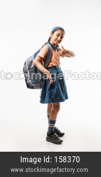 Indian girl in school uniform, standing isolated over white background ready to leave