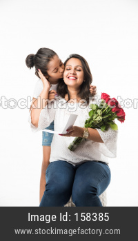 Mother's Day, mother and daughter with rose bouquet and greeting card