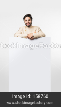 Indian man/boy holding white board or placard
