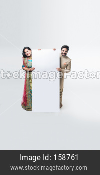 Indian couple holding white board or placard
