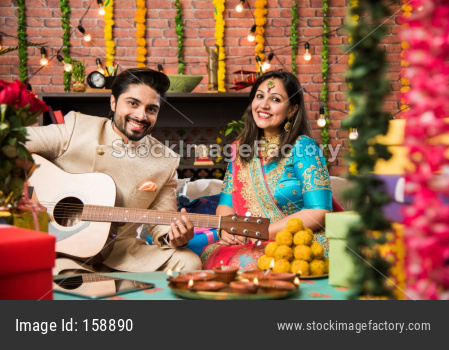 Man playing guitar for wife