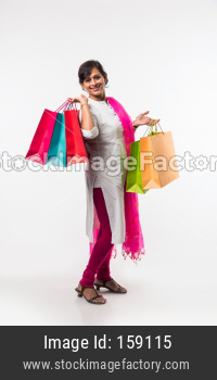 Indian lady/women with shopping bag, standing isolated over white background