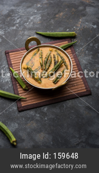 Hyderabadi Bhindi ka Salan or Okra salan made using ladies' fingers or ochro. Main course recipe from India. served in a bowl. s