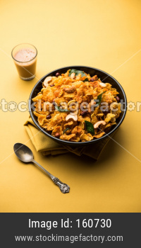 Cornflake Chivda or Corn Chiwda loaded with peanuts and Cashew. Served in a bowl. selective focus