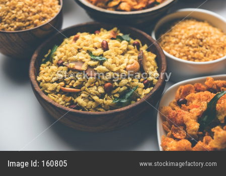 Group of Cornflake and Thick Poha Chivda or Chiwda and Chatpata Masala chana and fried crispy Moong Dal, served in a bowl. selec