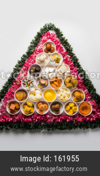 Flower Rangoli with sweets/mithai and diya