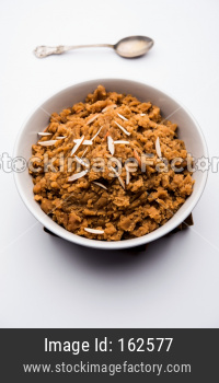 Wheat flour Halwa or Shira or porridge /  Atte ka Halva, Popular healthy dessert or breakfast menu from India. served in a bowl
