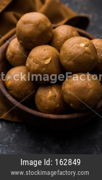 Churma Ladoo / atta laddoo / wheat flour laddu made using ghee and jaggery or sugar. selective focus