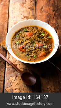 Whole Green Moong Dal fry / Whole Mung bean Tadka served in a bowl. selective focus
