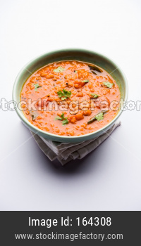 Red Lentil Cooked Dal or Dhal or Masoor daal tadka served in a bowl, selective focus