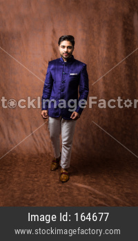 Male wears Coat / Sherwani, traditional Indian dress for wedding or festival