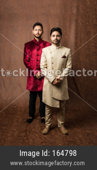 Two male models wearing sherwani / jodhpuri or kurta pyjama
