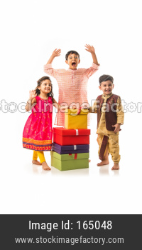 Cute little Indian Kids with gift boxes, standing isolated over white background