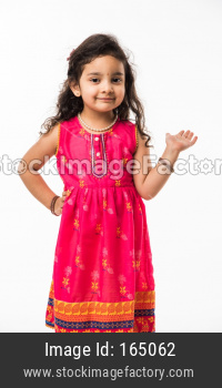 Portrait of cute little Indian girl model, standing isolated over white background