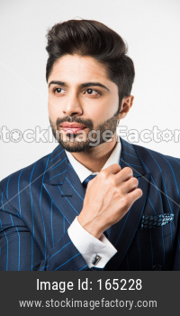 Portrait of Indian Male businessman standing over white background