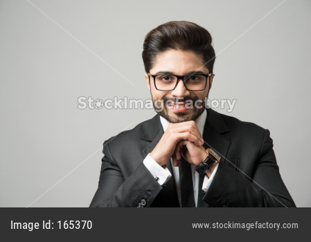 Indian businessman wears glasses or spectacles, bearded young businessman with eyewear