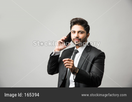 Indian business man using cell phone