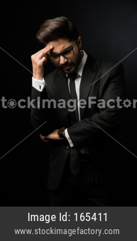 Indian businessman having headache