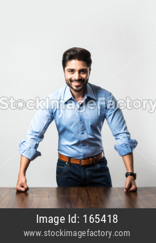 Indian businessman standing at table