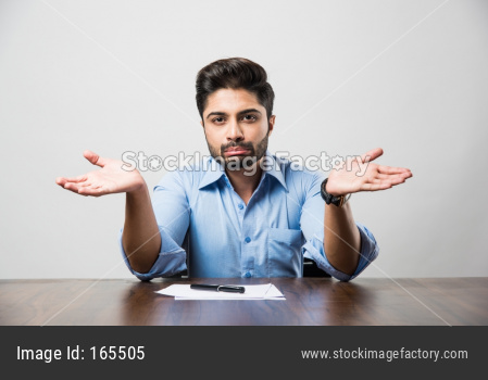 spread both hands by Indian businessman, helpless expressions, sitting at office table