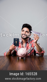 Piggy Bank, Passport and flight - Indian man with money box and paper plane, showing saving and foreign tour concept
