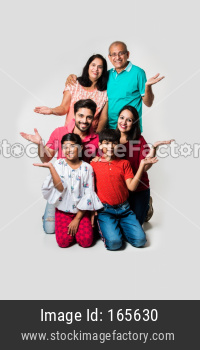 Indian family isolated over white background