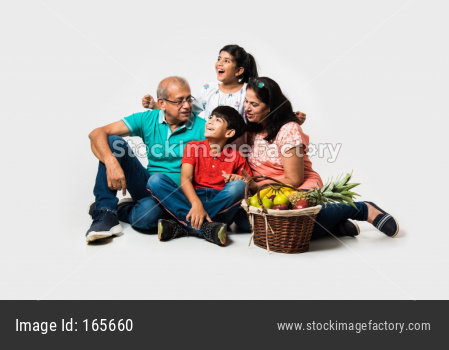 Kids with grandparents sitting over white background