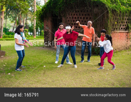Indian Family playing blindfold game in park or garden