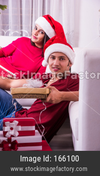 Indians celebrating Christmas or Xmas with family indoors