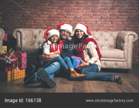 Indian Old couple celebrating Christmas / Xmas