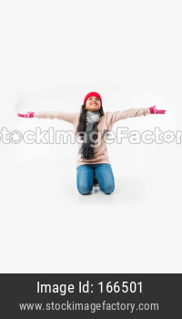Indian cute little girl in winter wear, seating against white background