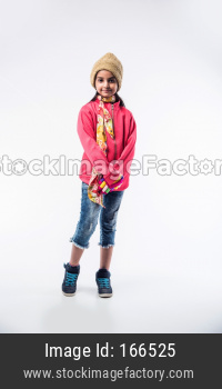 Indian cute little girl in winter wear, standing against white background