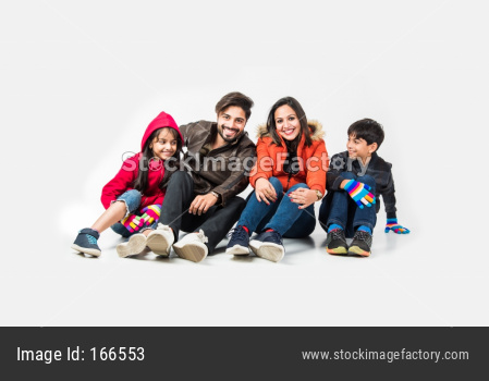 Indian family in warm clothes sitting against white background. Ready for winter