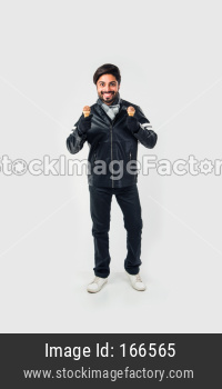 Indian man eating Ice Cream in warm clothes on white background