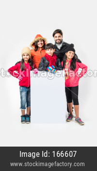 Indian people in warm clothes holding blank white board or placard, Indian winter season fashion